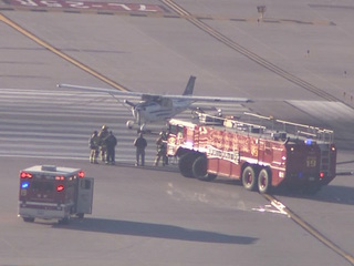 Small plane tips over at Sky Harbor