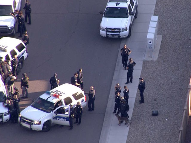 Suspect loose in west PHX PD-involved shooting