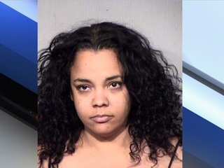 PD: Woman takes police gear after warrant arrest