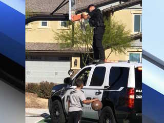 Buckeye officer helps fix broken basketball hoop