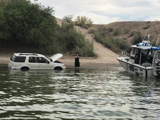 Men drive car into Lake Havasu while making bet