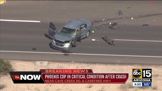 Phoenix officer in critical condition after crash