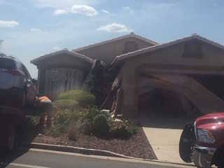 Woman hurt after crashing into Surprise home
