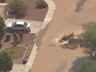 Water line break floods W. Phoenix neighborhood
