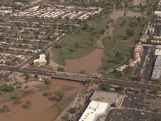 Storm runoff closes 15 roads in Scottsdale