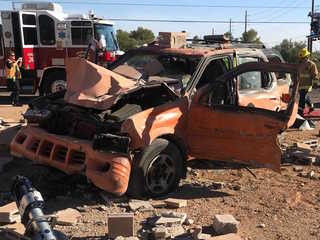 FD: Two critical after vehicle crashes into wall