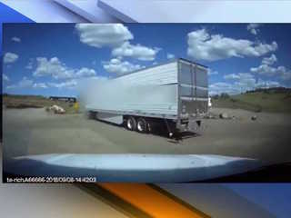 VIDEO: Semi with dog tied up pulled over