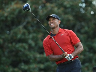 HE'S BACK: Tiger wins for 1st time since 2013