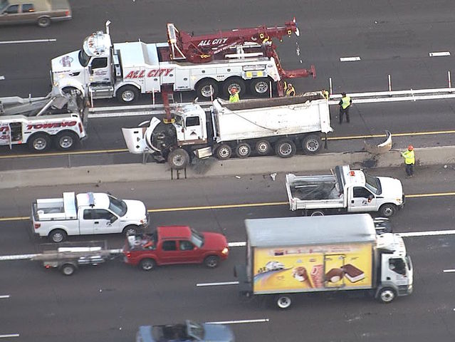 Dump truck, car roll over on US 60 in Tempe