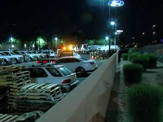 Vehicle on US-60 crashes into dealership lot