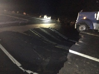Woman killed after storms wash away part of US89