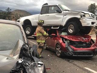Truck lands on top of car in Prescott crash