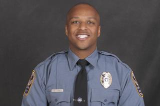 Officer fatally shot near school; suspects fled