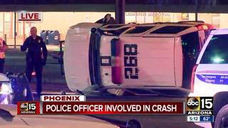 Police officer hit by red light runner in PHX