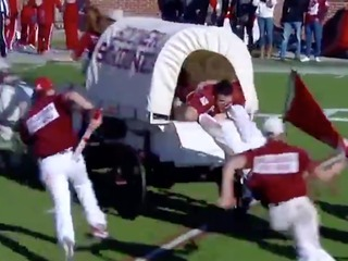 Man nearly falls off wagon during Oklahoma game